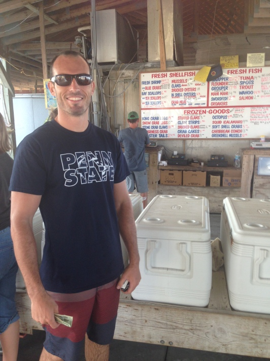 Mike picking out some fresh seafood at our local outdoor seafood market!